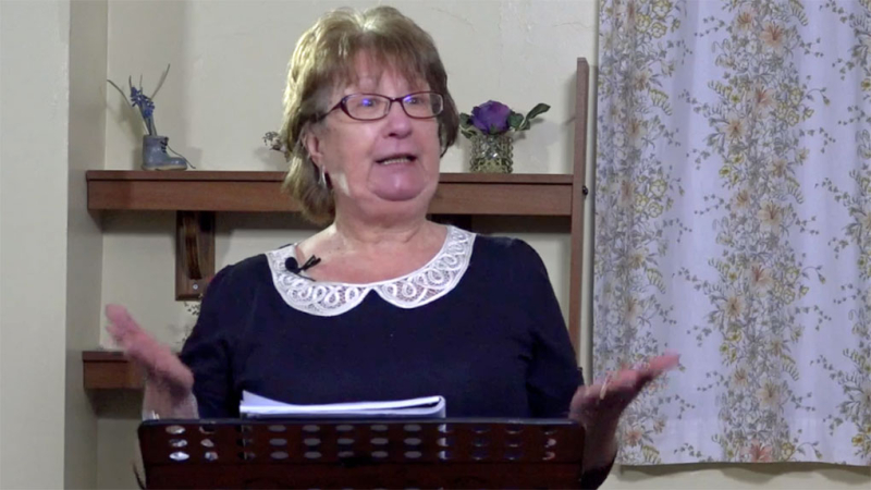 Sue-Solloway-South-Lancaster-Speakers-Club-standing-at-lecturn