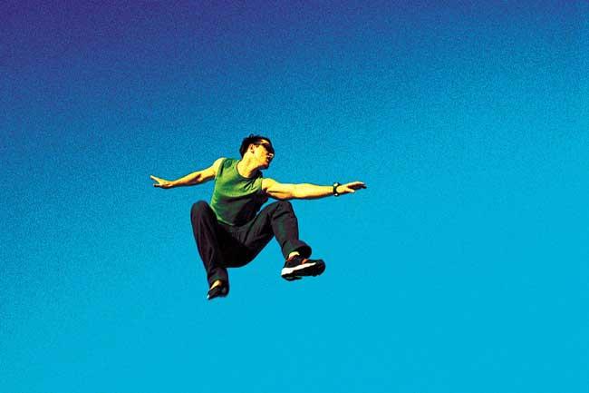 Snowflake millenial generation man jumping
