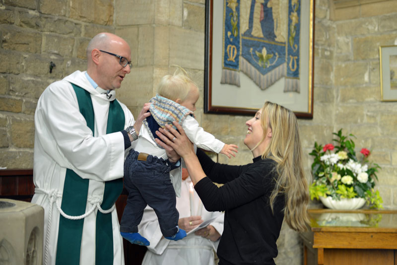 Infant-being-christen-in-a-church
